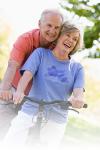 Senior couple on bike faded